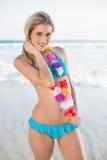 Cheerful sexy blonde in bikini wearing hawaii necklace Stock Photo