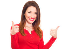 Cheerful sexy woman in red shows thumbs up with two hands Stock Photos