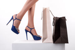 Cheerful sexy young woman loves going shopping Royalty Free Stock Image