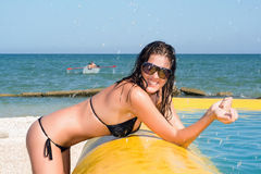 Young woman by the yellow pool Royalty Free Stock Images