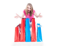 Cheerful shopaholic woman with many present or shopping bags Stock Images