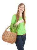 Cheerful shopping girl with wicker basket Royalty Free Stock Photos