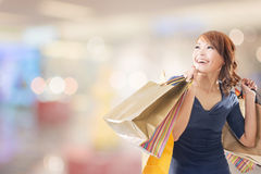 Cheerful shopping woman Stock Photo