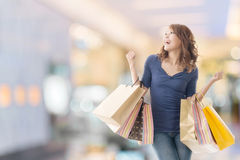 Cheerful shopping woman Stock Images
