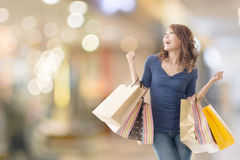 Cheerful shopping woman Stock Photography