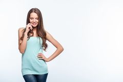 Cheerful shy young woman with pretty smile Royalty Free Stock Images