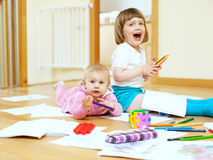 Cheerful sibling  in home. Cheerful sibling plays in home interior Stock Image