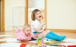 Cheerful sibling plays in home. Interior Royalty Free Stock Photography