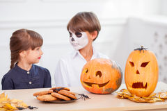 Cheerful siblings are decorating food before Nut Royalty Free Stock Images