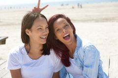 Cheerful sisters having fun at the beach Stock Image