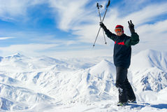 Cheerful skier on the top of mountain Stock Photography