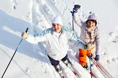 Cheerful skiers Stock Photo