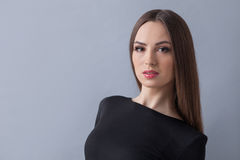 Cheerful slim girl is trying to seduce. Waist up portrait of beautiful young woman expressing her sexuality. She is standing and looking at the camera with Stock Images