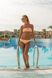 Cheerful slim woman on pool rails Stock Photos