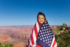 Cheerful small boy with USA flag, Grand Canyon Stock Images