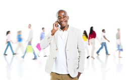 A Cheerful Smart Casual Guy on a Mobile Phone Stock Photography