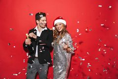 Cheerful smartly dressed couple standing stock photos