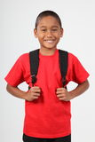 Cheerful smile from young boy 9 wearing school bac royalty free stock photo