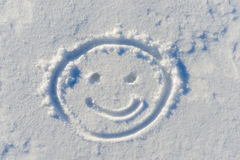 Cheerful smiley face on snow Royalty Free Stock Images