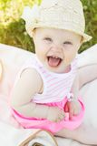 Cheerful smiling baby girl is wearing hat Royalty Free Stock Images