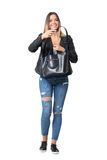 Cheerful smiling casual woman wearing jeans and jacket holding handbag Stock Photo