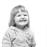 Cheerful smiling child. Little girl having fun playing. black-and-white photo Royalty Free Stock Photography