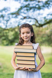 Cheerful smiling children girl hold chalkboard at the park . Sch Stock Photography