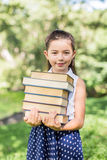 Cheerful smiling children girl hold chalkboard at the park . Sch Royalty Free Stock Photography