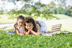 Cheerful smiling children girl hold chalkboard at the park . Sch Royalty Free Stock Images