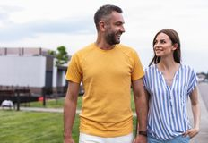 Cheerful smiling couple walking down the street royalty free stock photo
