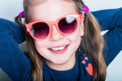 Cheerful smiling cute child with teeth dropped out Royalty Free Stock Image