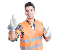 Cheerful smiling engineer showing thumbs up with both hands Royalty Free Stock Photo
