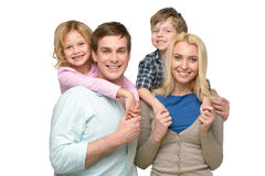 Cheerful smiling family of four looking at camera Royalty Free Stock Photography