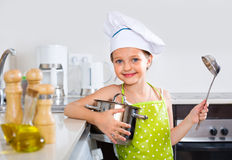 Cheerful smiling girl posing with pan Stock Photography