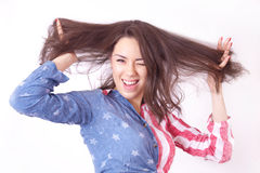 Cheerful smiling girl. With unruly brown hair Royalty Free Stock Photo