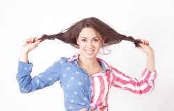 Cheerful smiling girl. With unruly brown hair Royalty Free Stock Photos