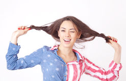 Cheerful smiling girl. With unruly brown hair Royalty Free Stock Photography
