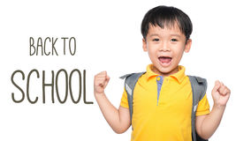 Cheerful smiling little boy with big backpack jumping and having fun against white wall. Looking at camera. School concept. Back t Royalty Free Stock Image