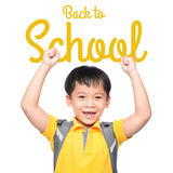 Cheerful smiling little boy with big backpack jumping and having fun against white wall. Looking at camera. School concept. Royalty Free Stock Photo
