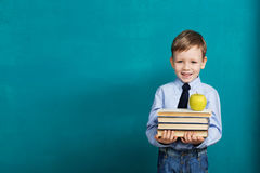 Cheerful smiling little kid against chalkboard royalty free stock photos
