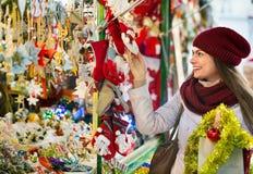 Cheerful smiling  woman choosing Christmas decoration Stock Image