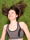 Cheerful smiling woman on green grass royalty free stock photo