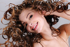 Cheerful smiling woman with long curly hairs Royalty Free Stock Photos