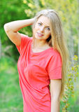 Cheerful smiling young beautiful blond woman. Portrait of happy cheerful smiling young beautiful blond woman, outdoors stock images