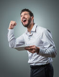 Cheerful smiling young man with tablet Royalty Free Stock Photo