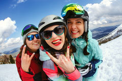 Cheerful snowboarder posing on top of a mountain Stock Photography