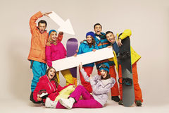 Cheerful snowboarders with fancy signs Royalty Free Stock Photo