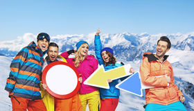 Cheerful snowboarders with funy signs Royalty Free Stock Photos