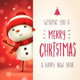 Cheerful snowman with big signboard. Merry Christmas calligraphy lettering design. Creative typography for holiday greeting. Christmas cute cartoon character royalty free illustration