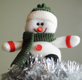 Cheerful snowman in hat Stock Photos